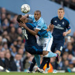 Fernandinho of Manchester City (centre) is held back by Casemiro of Real Madrid (left) during the UEFA Champions League match at the Etihad Stadium, Manchester Picture by Russell Hart/Focus Images Ltd 07791 688 420 26/04/2016