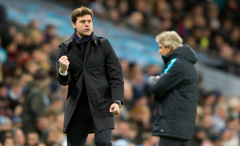 Tottenham Hotspur manager Mauricio Pochettino (left) celebrates after Christian Eriksen gave his team a 2-1 lead, as Manchester City manager Manuel Pellegrini expresses his frustration in the background, during the Barclays Premier League match at the Etihad Stadium, Manchester Picture by Russell Hart/Focus Images Ltd 07791 688 420 14/02/2016