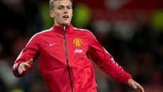 James Wilson of Manchester United warms up before the Barclays Premier League match at Old Trafford, Manchester Picture by Russell Hart/Focus Images Ltd 07791 688 420 02/12/2014