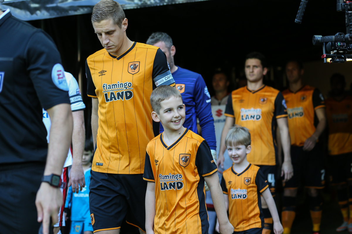 Michael Dawson of Hull City (centre) ;leads out the Hull City team with one of the mascots ahead of the Sky Bet Championship match at stadium:mk, Milton Keynes Picture by David Horn/Focus Images Ltd +44 7545 970036 31/10/2015