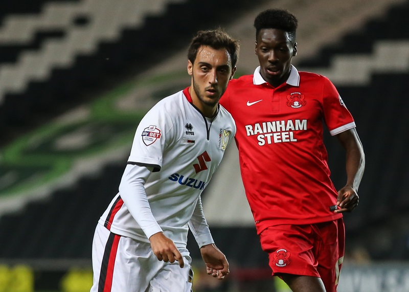 Sergio Aguza of Milton Keynes Dons and Bradley Pritchard of Leyton Orient during the Capital One Cup match at stadium:mk, Milton Keynes Picture by David Horn/Focus Images Ltd +44 7545 970036 11/08/2015