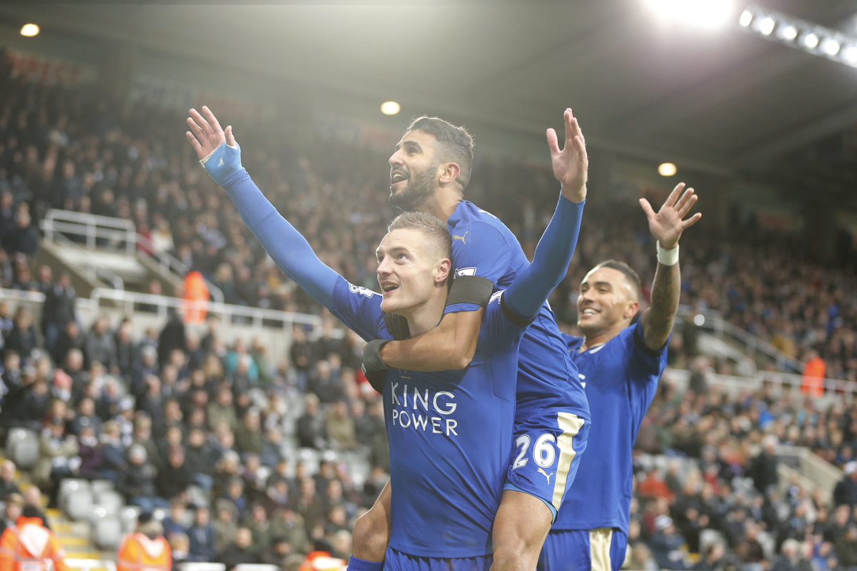 Jamie Vardy (l) of Leicester City celebrates scoring the opening goal during the Barclays Premier League match at St. James's Park, Newcastle Picture by Simon Moore/Focus Images Ltd 07807 671782 21/11/2015