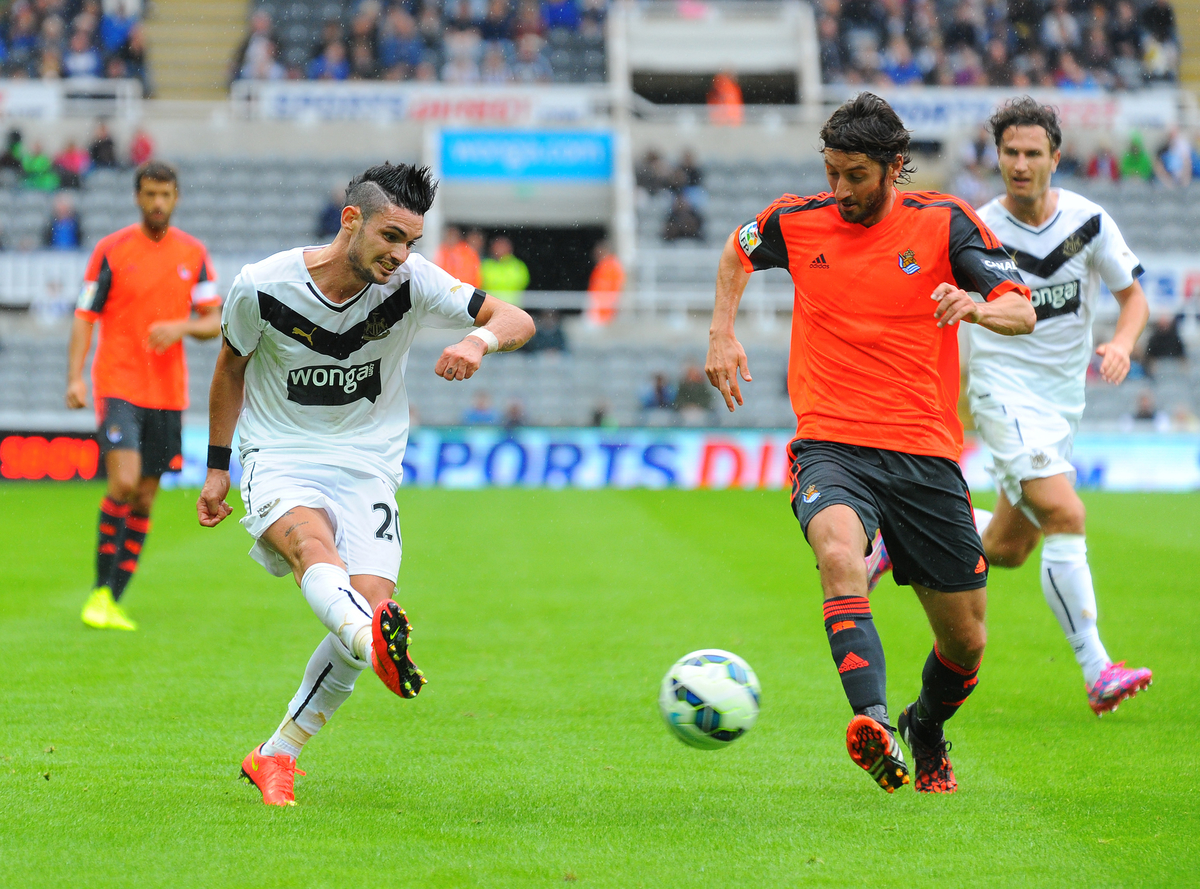 New signing Remy Cabella of Newcastle United (left) crosses the ball despite the attention of Yuri Berchiche of Real Sociedad during the pre season friendly match at St. James's Park, Newcastle Picture by Greg Kwasnik/Focus Images Ltd +44 7902 021456 10/08/2014