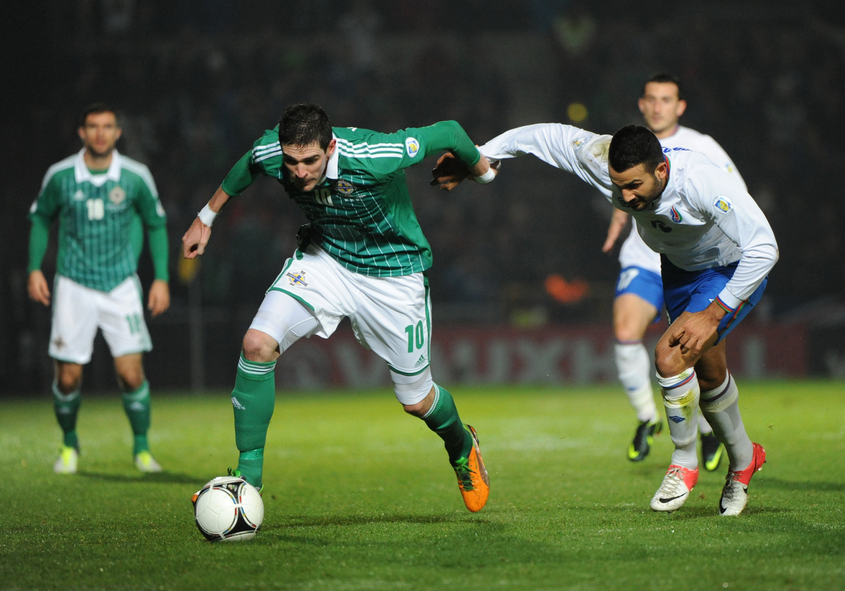Picture by Ramsey Cardey/Focus Images Ltd +44 7809 235323.14/11/2012.Kyle Lafferty of Northern Ireland and Ali Gokdemir of Azerbaijan chase for the ball during the 2014 FIFA World Cup Qualifying match at Windsor Park, Belfast.