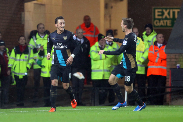Mesut Özil of Arsenal celebrates opening the scoring during the Barclays Premier League match at Carrow Road, Norwich Picture by Paul Chesterton/Focus Images Ltd +44 7904 640267 29/11/2015