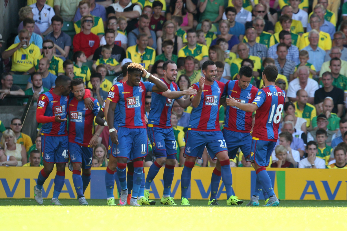 The Crystal Palace players celebrate their sides 2nd goal during the Barclays Premier League match at Carrow Road, Norwich Picture by Paul Chesterton/Focus Images Ltd +44 7904 640267 08/08/2015