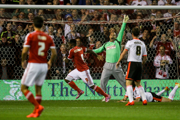 Keeper Gabor Kiraly of Fulham (2nd right) appeals for handball after Britt Assombalonga of Nottingham Forest (2nd left) scores for Forest during the Sky Bet Championship match at the City Ground, Nottingham Picture by Andy Kearns/Focus Images Ltd 0781 864 4264 17/09/2014