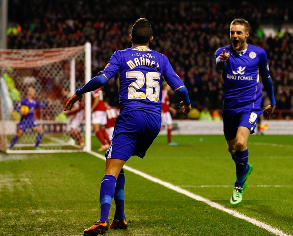 Riyad Mahrez of Leicester City celebrates scoring his team's second goal to make it 2-2 with Jamie Vardy of Leicester City (right) during the Sky Bet Championship match at the City Ground, Nottingham Picture by David Horn/Focus Images Ltd +44 7545 970036 19/02/2014