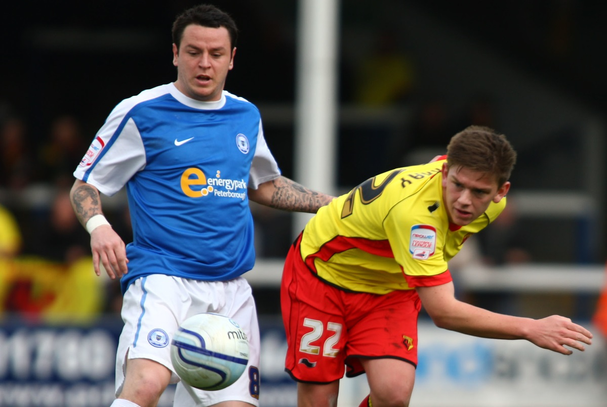 Lee Tomlin, a la izquierda, en su etapa en el Peterborough (Foto: Focus Images Ltd)