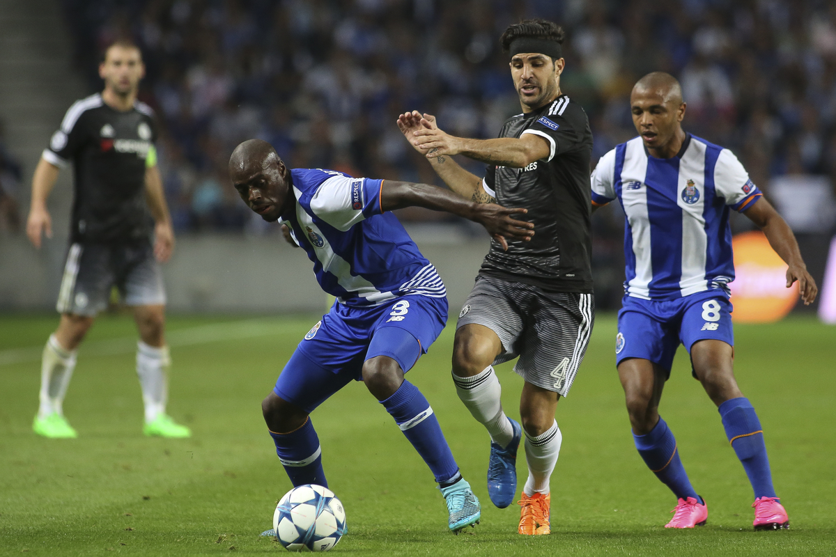 Bruno Martins Indi (left) and Brahimi of FC Porto battle with Cesc Fabregas of Chelsea and during the UEFA Champions League match at the Estádio do Dragão, Porto Picture by Pedro Lopes/Focus Images Ltd +54 936 360 807 29/09/2015