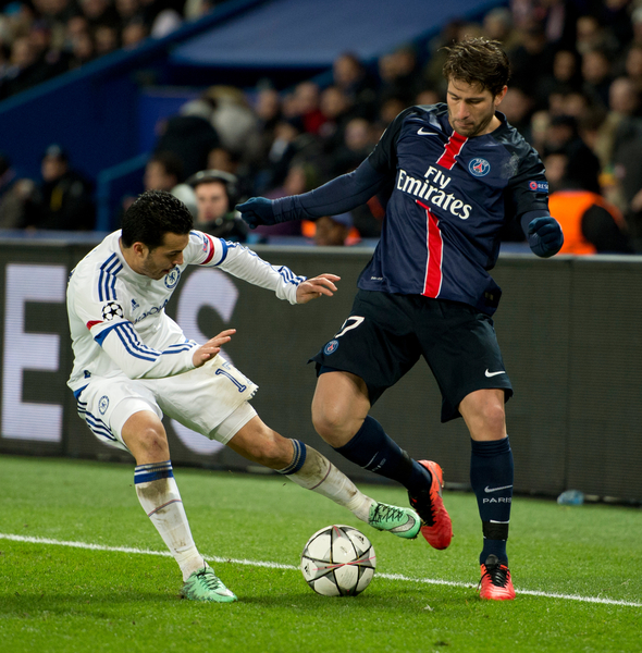 Pedro of Chelsea (left) and Maxwell of Paris Saint-Germain (right) challenge for the ball during the UEFA Champions League match at Parc des Princes, Paris Picture by Russell Hart/Focus Images Ltd 07791 688 420 16/02/2016
