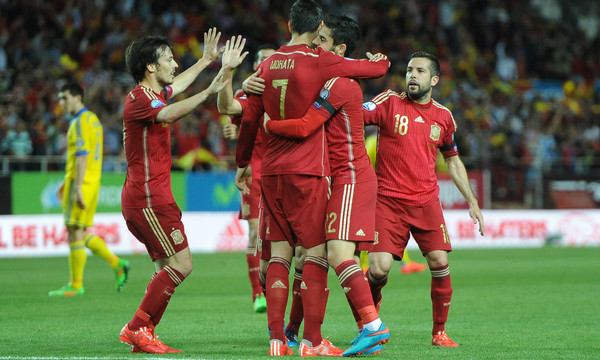 Alvaro Morata of Spain celebrates scoring their first goal with team mates during the UEFA Euro 2016 Qualifying match at Estadio Ramón Sánchez-Pizjuán, Seville Picture by Daniel Hambury/Focus Images Ltd +44 7813 022858 27/03/2015