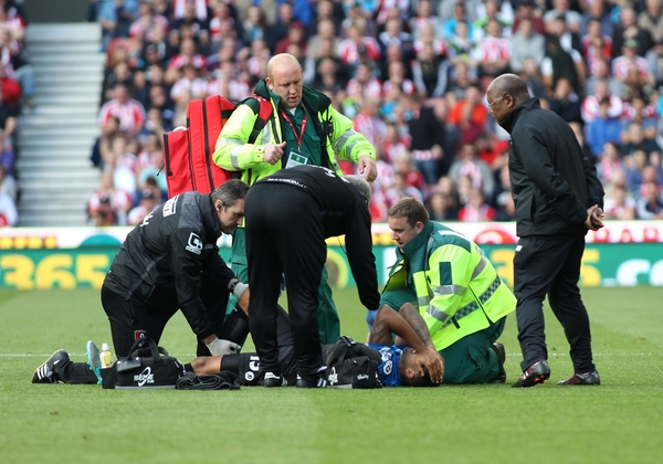 Callum Wilson of Bournemouth is attended by the medical staff as he lies injured before being stretchered off the field during the Barclays Premier League match against Stoke City at the Britannia Stadium, Stoke-on-Trent. Picture by Michael Sedgwick/Focus Images Ltd +44 7900 363072 26/09/2015