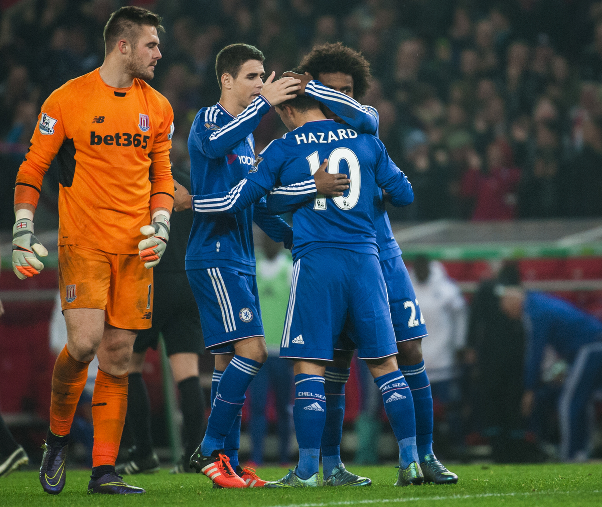 Eden Hazard of Chelsea is conuled by Oscar of Chelsea and Willain of Chelsea  during the Capital One Cup match at the Britannia Stadium, Stoke-on-Trent  Picture by Jack Megaw/Focus Images Ltd +44 7481 764811 27/10/2015
