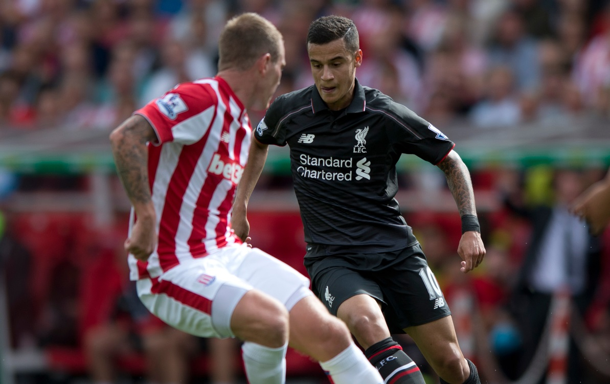 Philippe Coutinho of Liverpool (right) takes on Glenn Whelan of Stoke City during the Barclays Premier League match at the Britannia Stadium, Stoke-on-Trent Picture by Russell Hart/Focus Images Ltd 07791 688 420 09/08/2015