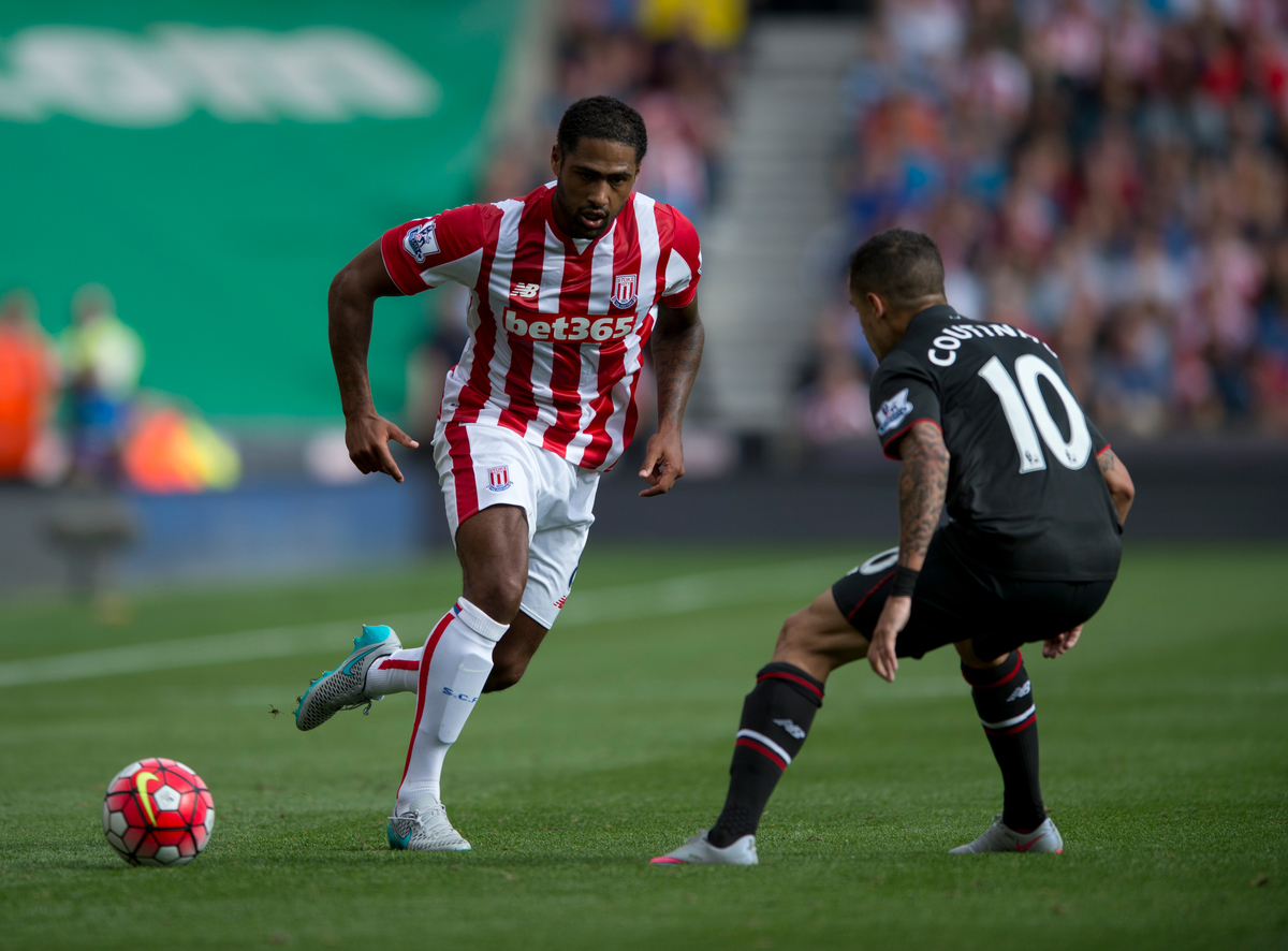 Glen Johnson of Stoke City (left) plays the ball before Philippe Coutinho of Liverpool (right) can arrive during the Barclays Premier League match at the Britannia Stadium, Stoke-on-Trent Picture by Russell Hart/Focus Images Ltd 07791 688 420 09/08/2015