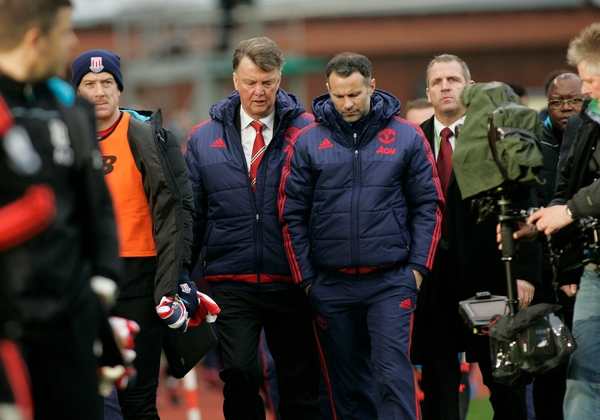 Louis van Gaal manager of Manchester United leaves the touchline with Ryan Giggs at half time, during the Barclays Premier League match against Stoke City at the Britannia Stadium, Stoke-on-Trent. Picture by Michael Sedgwick/Focus Images Ltd +44 7900 363072 26/12/2015