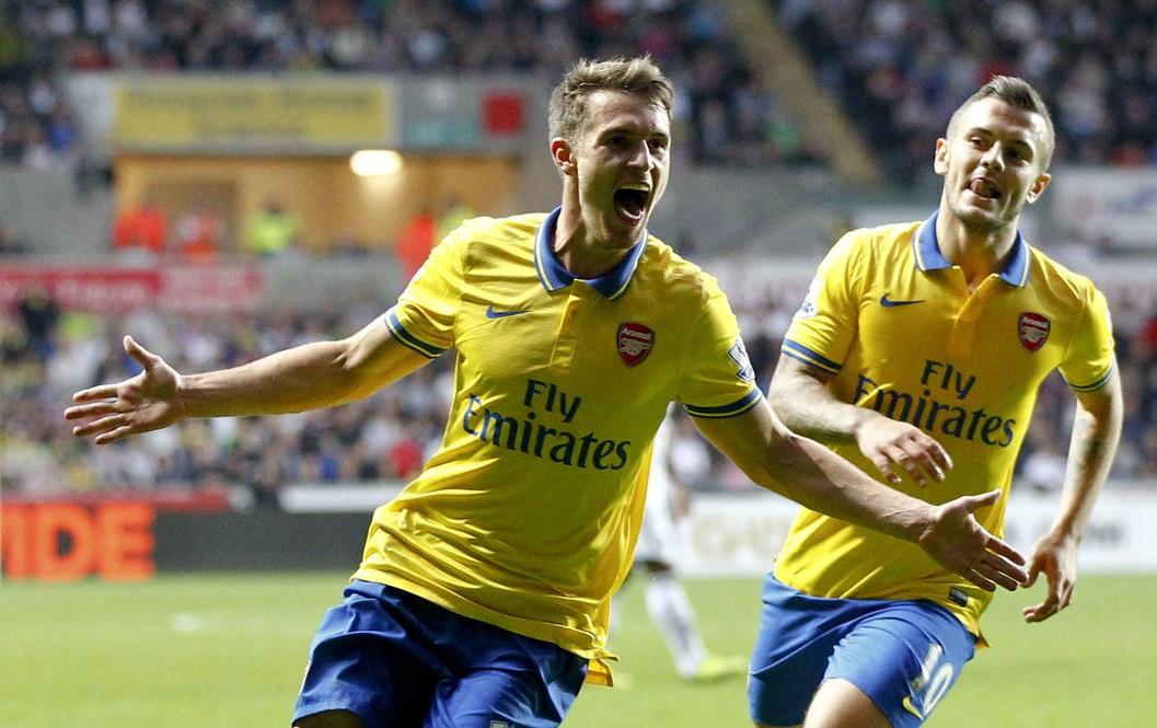 Picture by Mike  Griffiths/Focus Images Ltd +44 7766 223933 28/09/2013 Aaron Ramsey (L) and Jack Wilshere (R) of Arsenal celebrates the second goal during the Barclays Premier League match at the Liberty Stadium, Swansea.