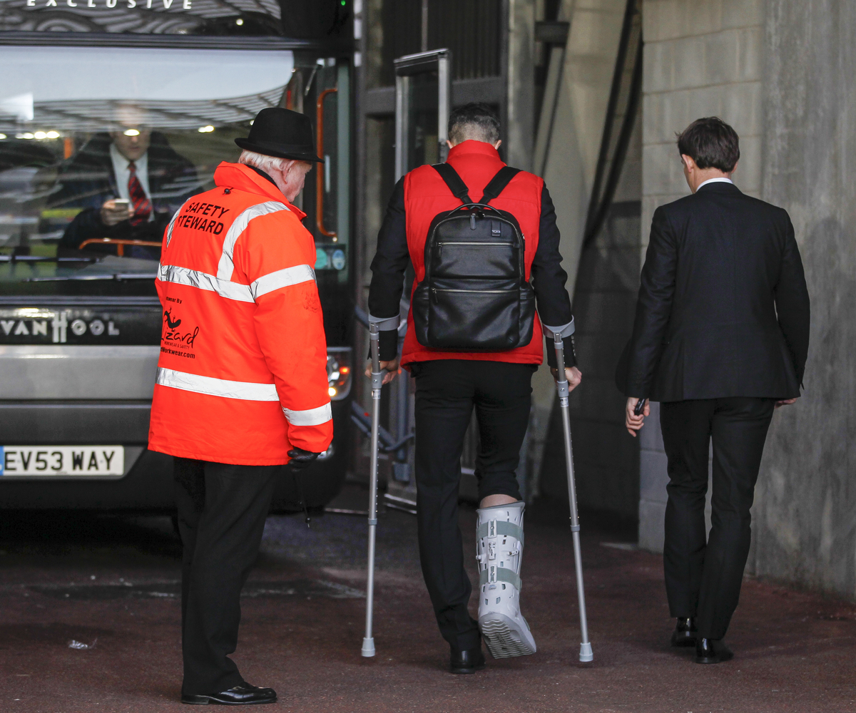 Robin Van Persie of Manchester United leaves the Liberty stadium on crutches after the Barclays Premier League match at the Liberty Stadium, Swansea Picture by Mike Griffiths/Focus Images Ltd +44 7766 223933 21/02/2015