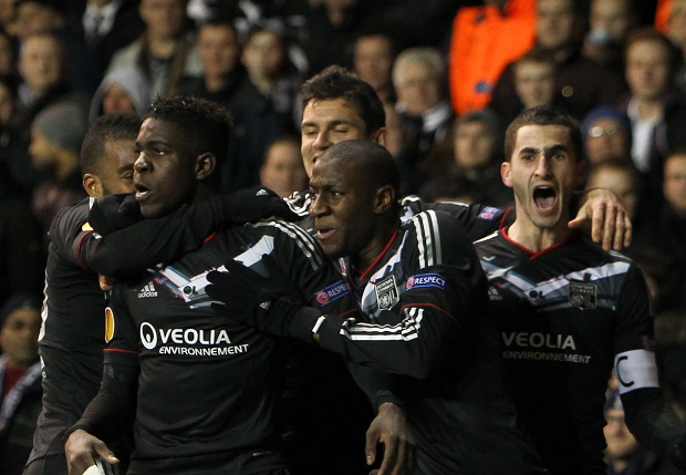 Picture by John  Rainford/Focus Images Ltd +44 7506 538356.14/02/2013.Samuel Umtiti of Olympique Lyonnais celebrates with team-mates after his equaliser against Tottenham Hotspur during the UEFA Europa League match at White Hart Lane, London.