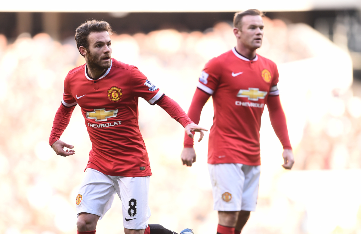 Juan Mata and Wayne Rooney of Manchester United during the Barclays Premier League match against Tottenham Hotspur at White Hart Lane, London Picture by Andrew Timms/Focus Images Ltd +44 7917 236526 28/12/2014