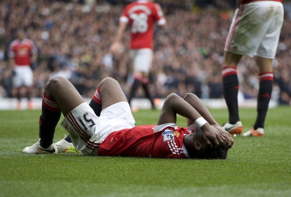 Timothy Fosu-Mensah of Manchester United goes down injured during the Barclays Premier League match at White Hart Lane, London Picture by Alan Stanford/Focus Images Ltd +44 7915 056117 10/04/2016