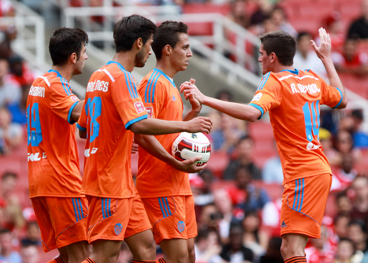 Players from Valencia Club de Futbol celebrate after Ricardo Carvalho of AS Monaco FC had put through his own goal to level during the Emirates Cup match at the Emirates Stadium, London Picture by John Rainford/Focus Images Ltd +44 7506 538356 02/08/2014