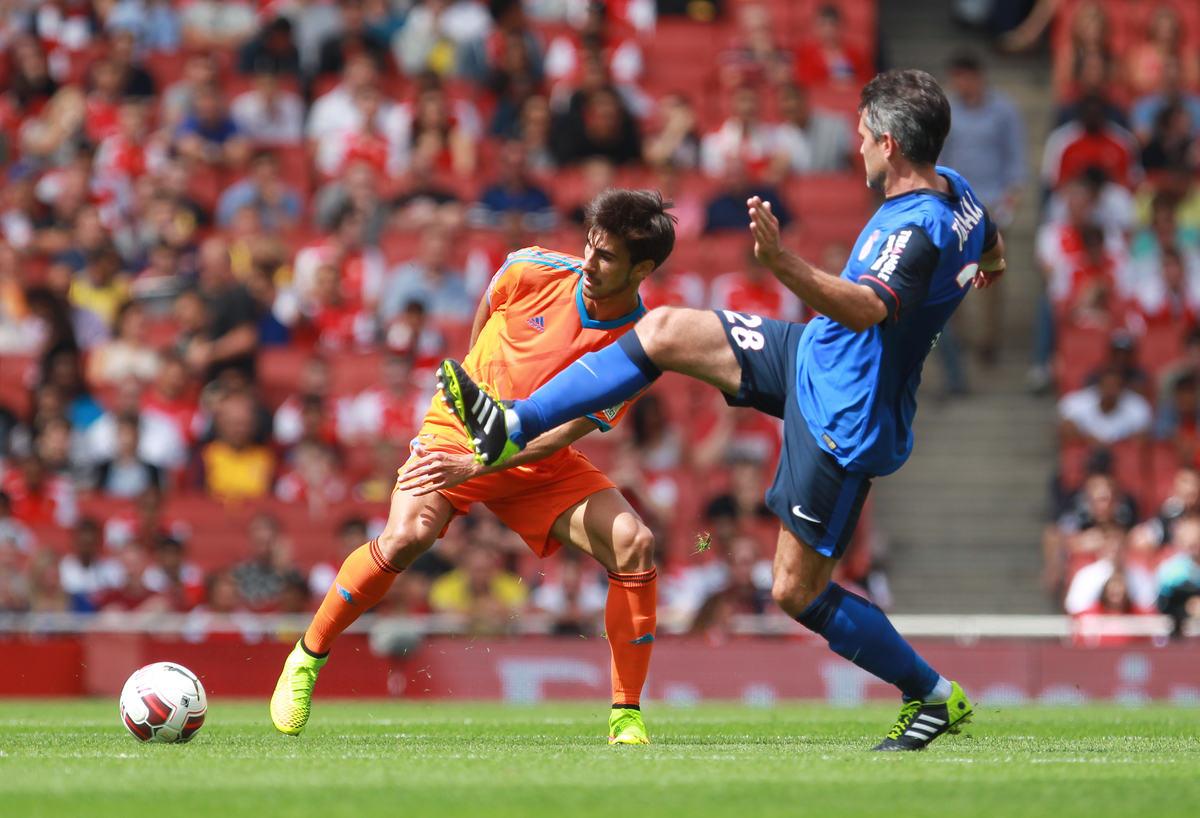Andre Gomes of Valencia Club de Fútbol and Jeremy Toulalan of AS Monaco FC during the Emirates Cup match at the Emirates Stadium, London Picture by John Rainford/Focus Images Ltd +44 7506 538356 02/08/2014