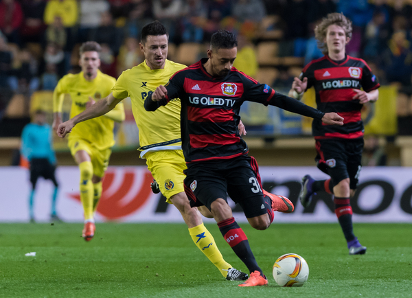 Antonio Rukavina of Villarreal CF and Karim Bellarabi of Bayer Leverkusen during the UEFA Europa League match at Estadio El Madrigal, Villarreal Picture by Maria Jose Segovia/Focus Images Ltd +34 660052291 10/03/2016