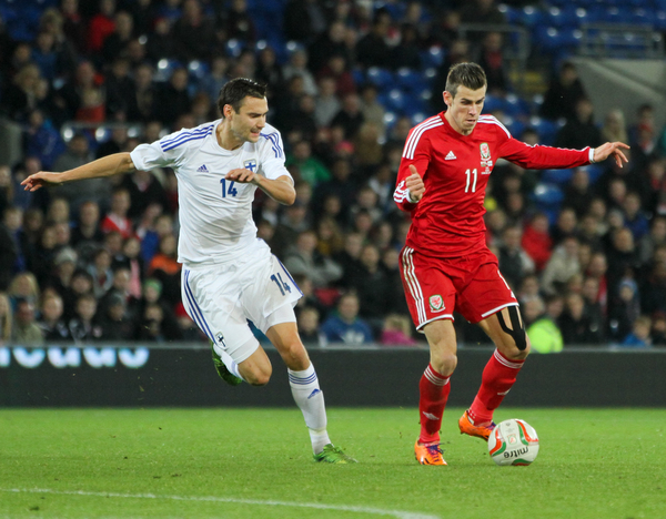 Picture by Tom Smith/Focus Images Ltd 07545141164 16/11/2013 Gareth Bale (right) of Wales keeps the ball away from Tim Sparv (left) of Finland during the International Friendly match at the Cardiff City Stadium, Cardiff.