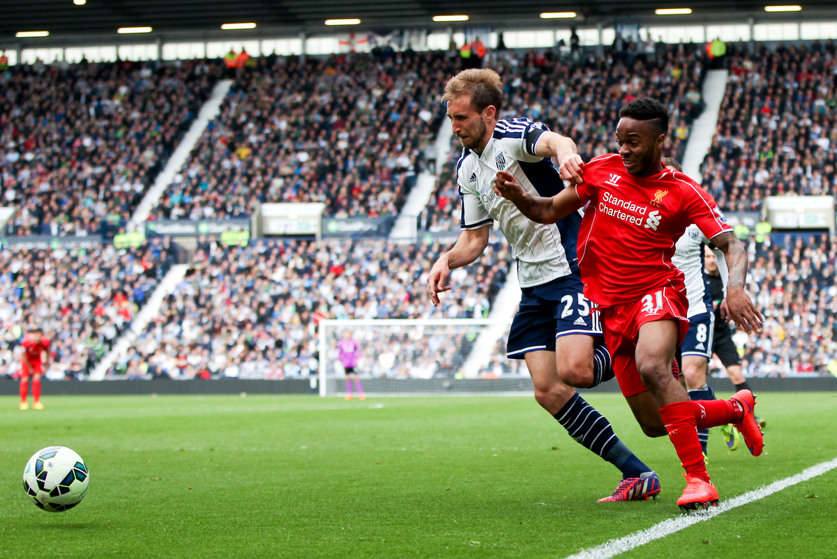 Raheem Sterling (right) of Liverpool tries to get past Craig Dawson (left) of West Bromwich Albion during the Barclays Premier League match at The Hawthorns, West Bromwich Picture by Tom Smith/Focus Images Ltd 07545141164 25/04/2015