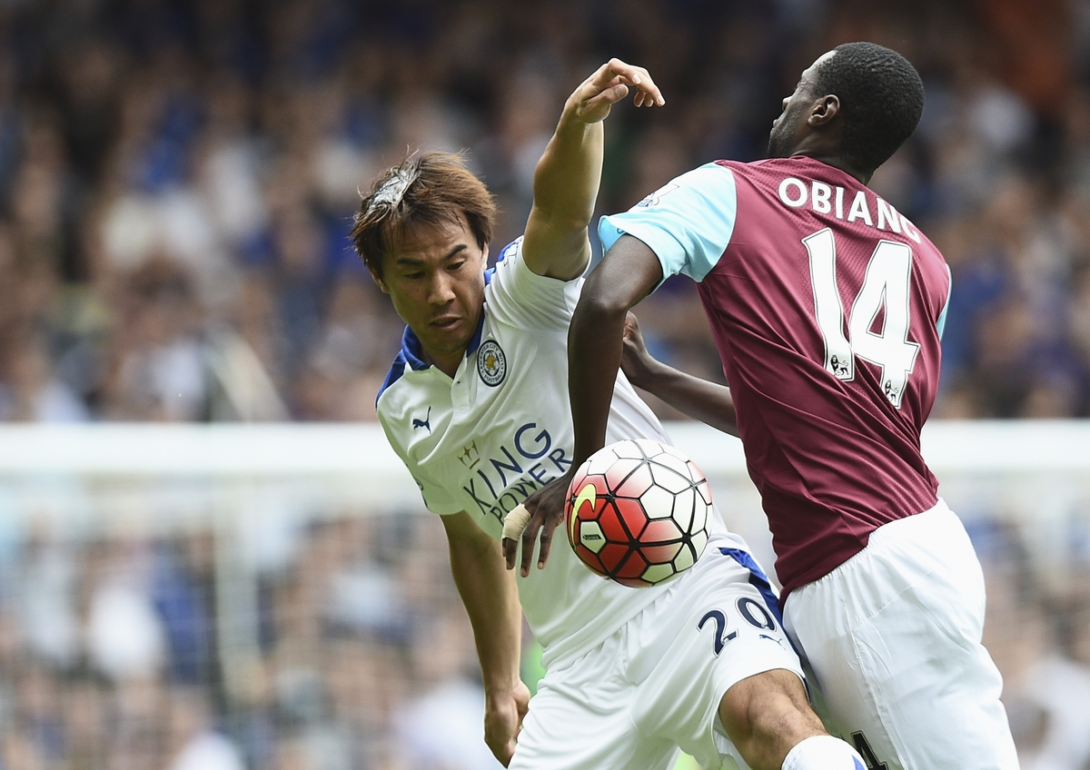 Shinji Okazaki of Leicester City and Pedro Obiang of West Ham United clash for the ball during the Barclays Premier League match at the Boleyn Ground, London Picture by Alan Stanford/Focus Images Ltd +44 7915 056117 15/08/2015