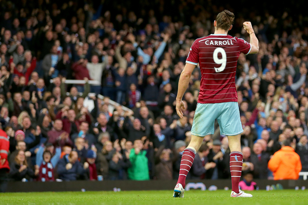 Andy Carroll of West Ham United celebrates with fans after scoring the opening goal of the Barclays Premier League match against Swansea City at the Boleyn Ground, London Picture by Richard Calver/Focus Images Ltd +447792 981244 07/12/2014