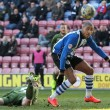 Leon Clarke of Wigan Athletic and Tim Ream of Bolton Wanderers in action during the Sky Bet Championship match at the DW Stadium, Wigan. Picture by Michael Sedgwick/Focus Images Ltd +44 7900 363072 21/03/2015