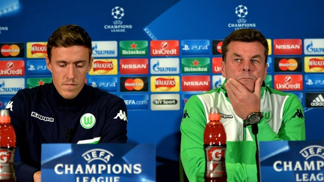 Max Kruse of Vfl Wolfsburg (left) and VfL Wolfsburg manager Dieter Hecking (right) during a press conference at Old Trafford, Manchester Picture by Ian Wadkins/Focus Images Ltd +44 7877 568959 29/09/2015
