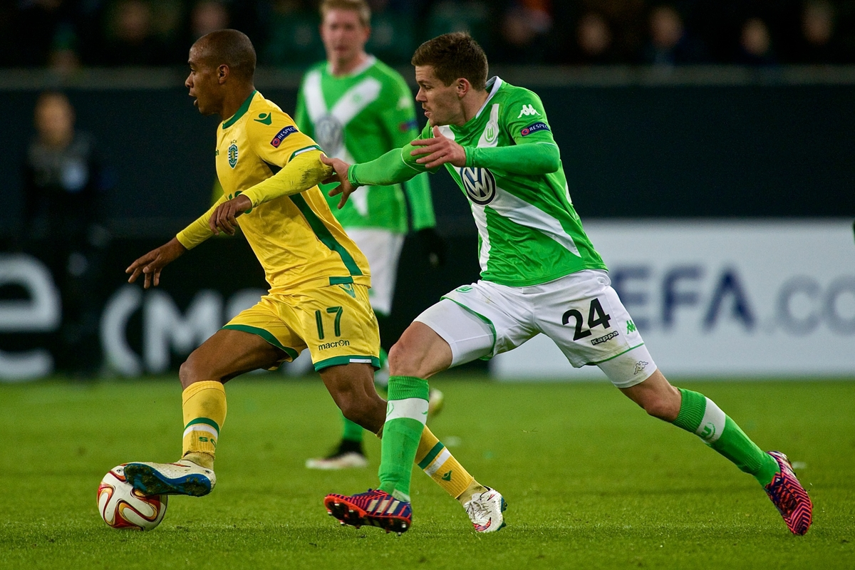 João Mário of Sporting Clube de Portugal (left) and Sebastian Jung of VfL Wolfsburg (right) during the UEFA Europa League match at Volkswagen Arena, Wolfsburg Picture by Ian Wadkins/Focus Images Ltd +44 7877 568959 19/02/2015